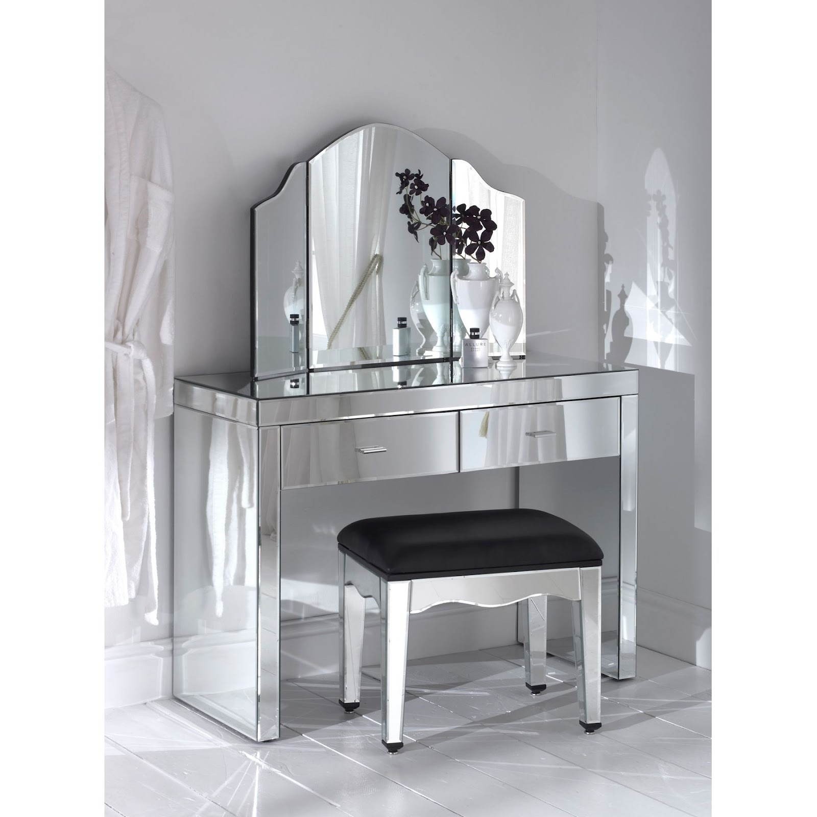 Modern dressing table furniture designs an interior design for Small mirrored dressing table set