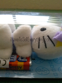 Hello Kitty Pez dispenser plush Easter Bunny lying down from side view