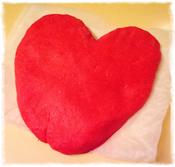 home made glitter and scented red play dough after being kneaded