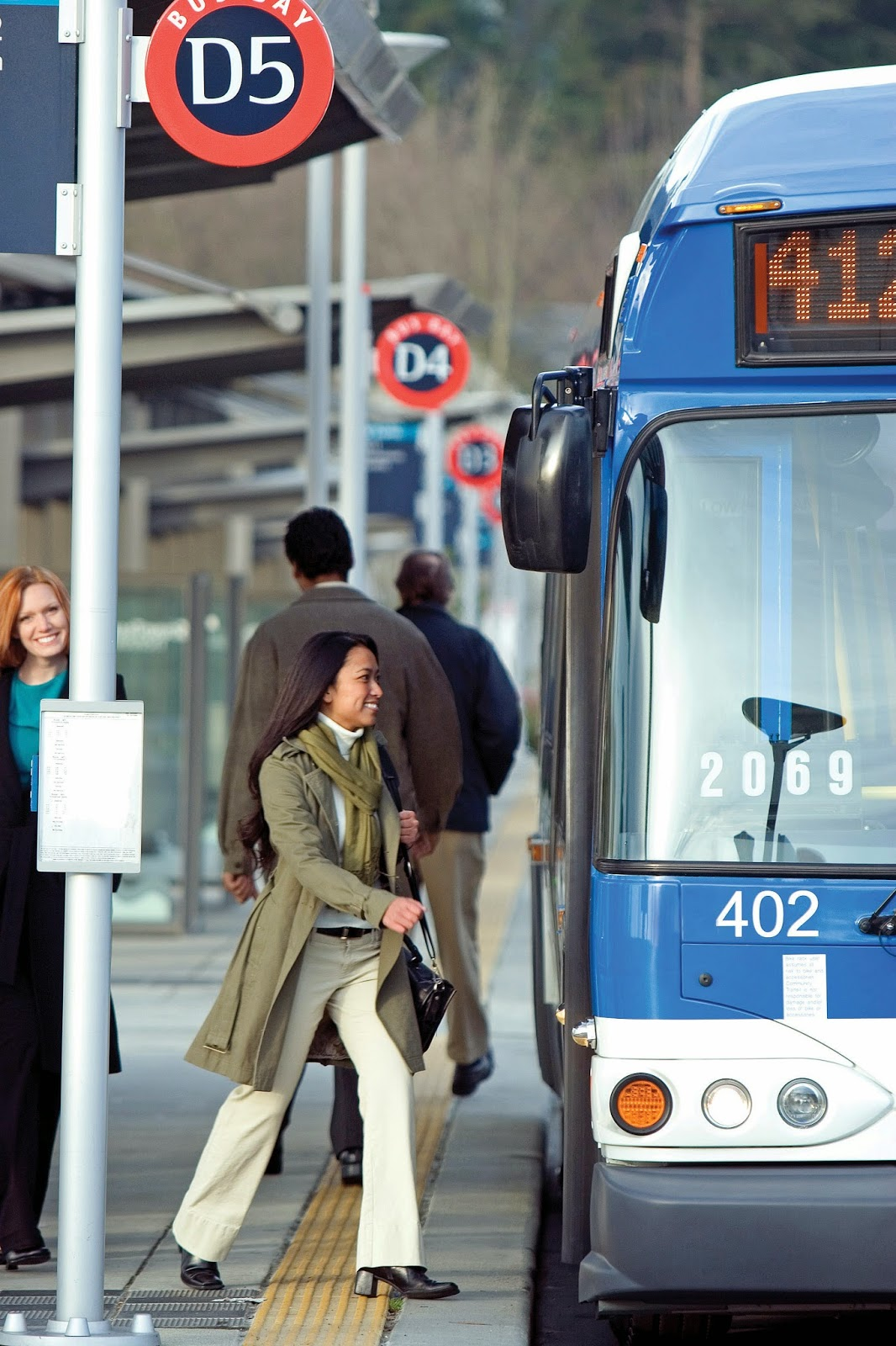 picture of woman boarding Route 412 bus