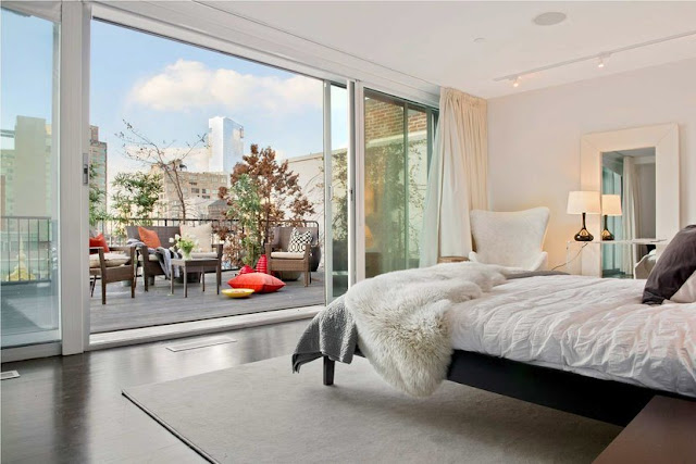 Bedroom in a Soho Condo in New York City that overlooks a balcony