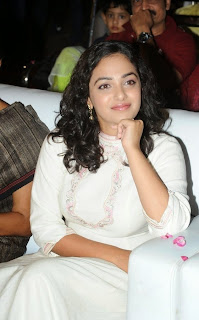 Actress Nithya Menen Pictures in White Long Dress at Malli Malli Idi Rani Roju Audio Launch  45.jpg