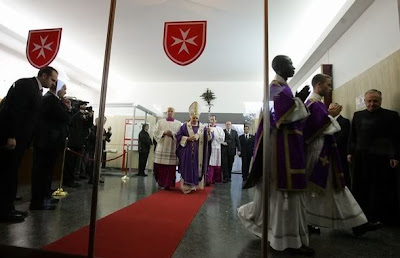 Pope Benedict XVI leaves after a mass celebrated at the Roman Hospital