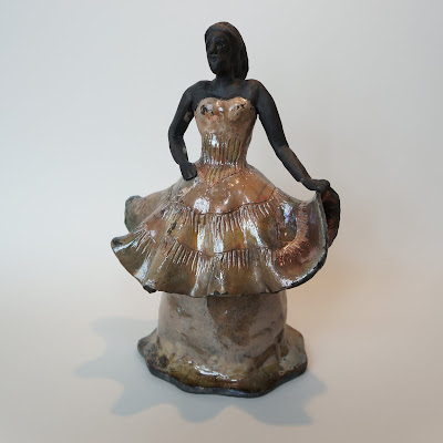 Beautiful lady raku fired pottery sculpture by Lily.