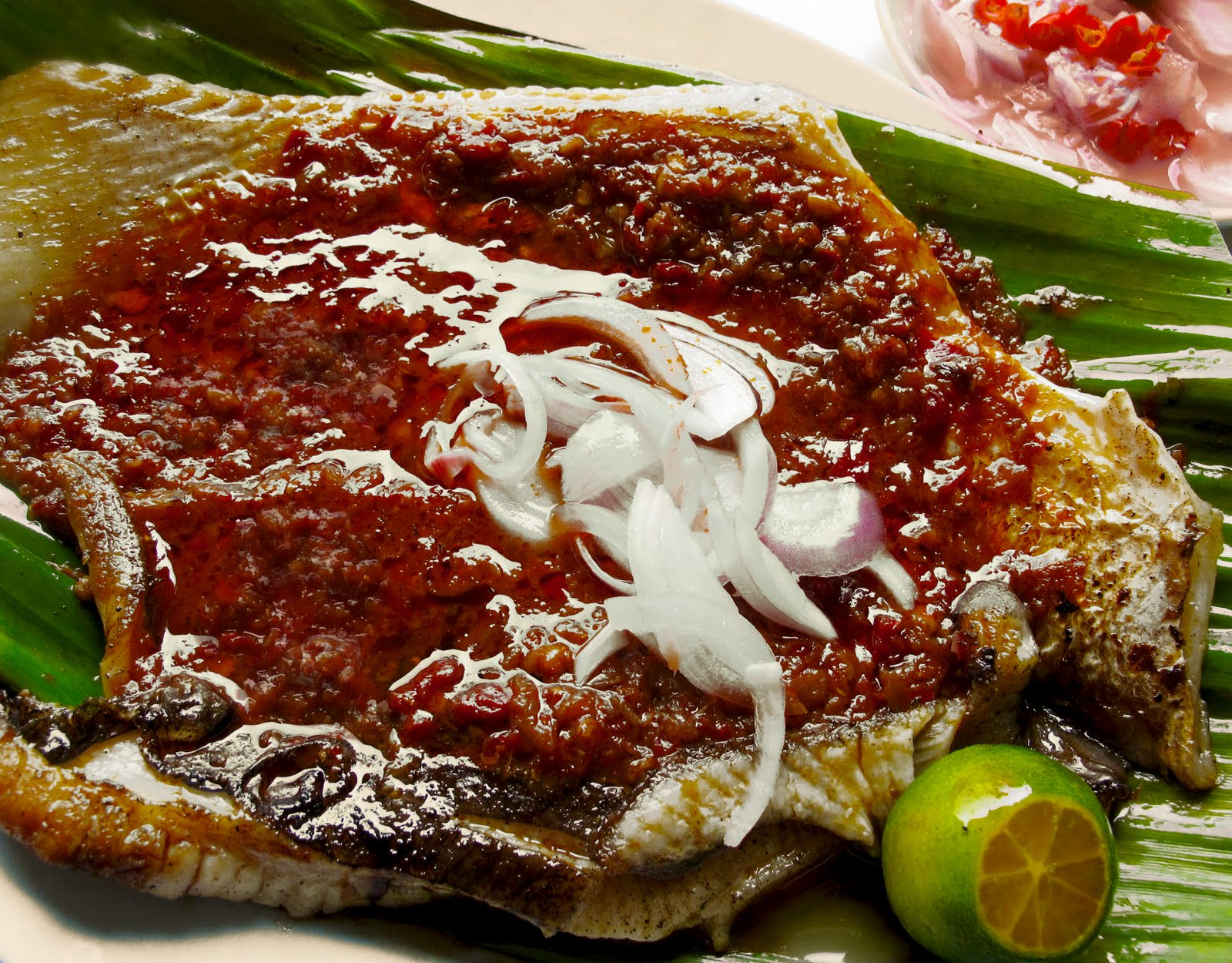 ... grilled whole in a similar way, on banana leaves with sambal chilli