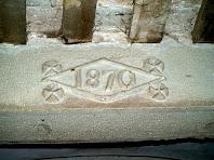 Llinda datada al 1870 de l'interior del mas del Fabregar
