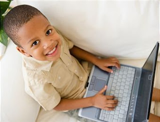 Smiling boy with a laptop