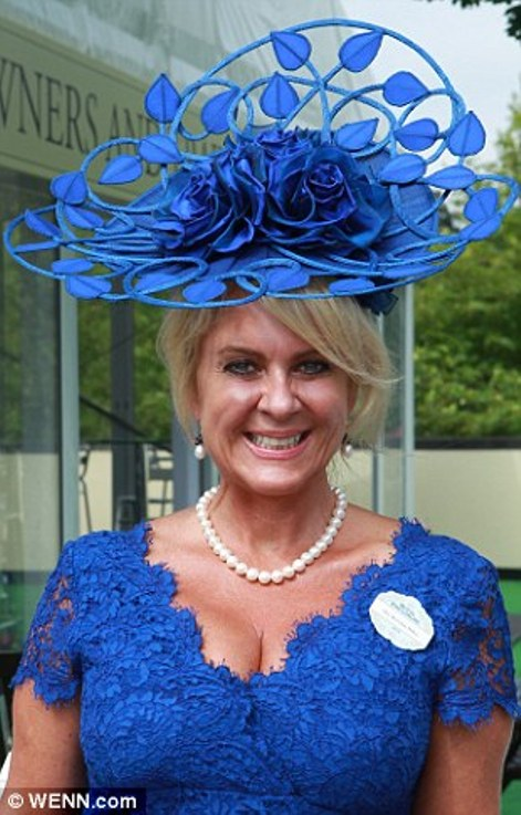 elegant lady in cobalt blue lace dress and matching hat on Ladies' Day of Royal Ascot 2014