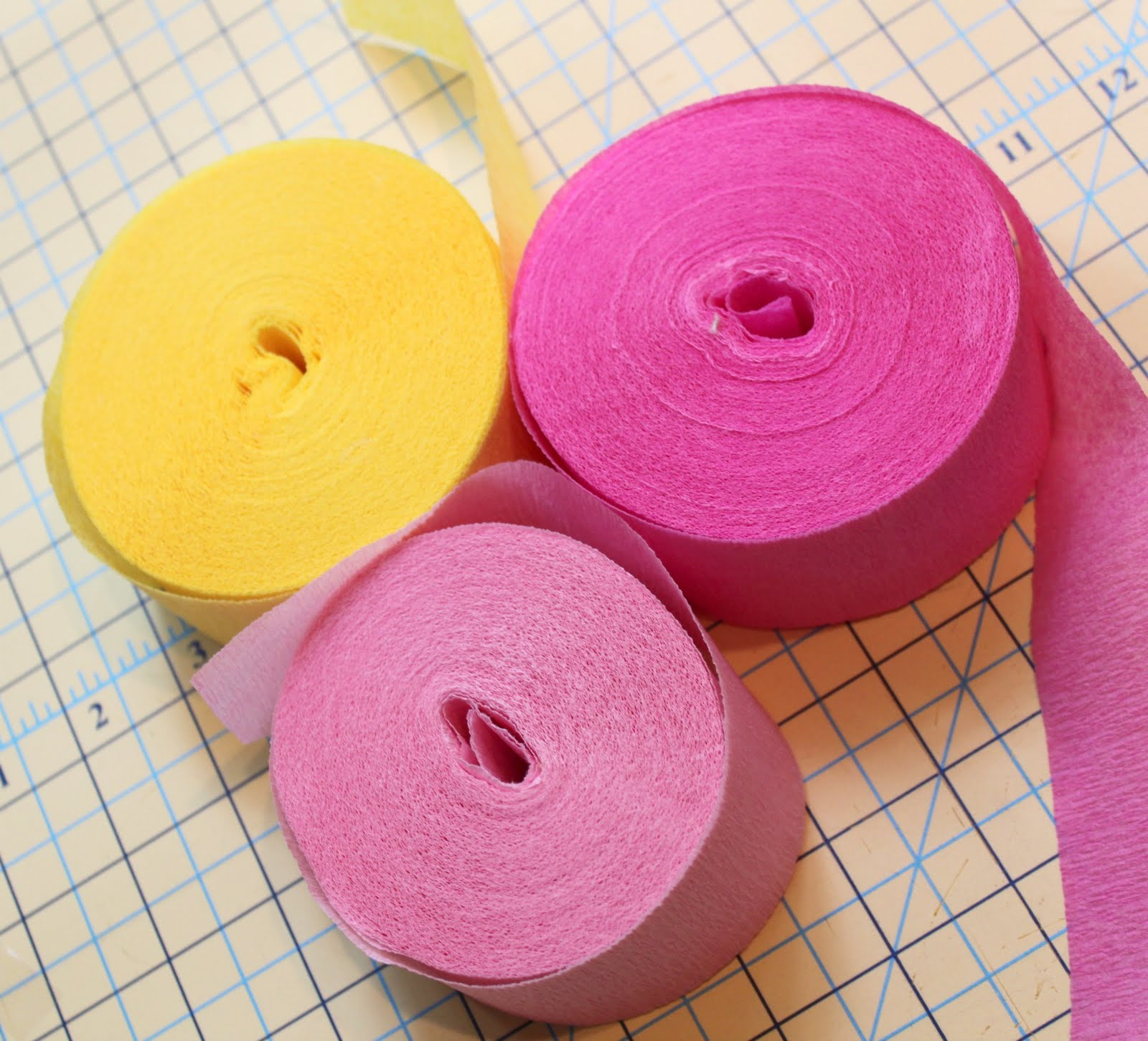 grab your three rolls of crepe paper i chose two different shades of pink and yellow i purchased these at walmart for 100 per roll and they coordinated