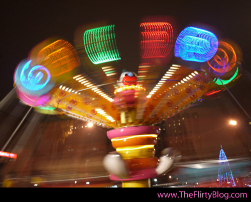 ... taking pictures of the carnival rides across the street along Park Ave.