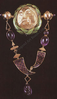 BROOCH Fred Rich - This is a chased 18-carat gold enamel and amethyst brooch. Cloisonné and Basse taille enamel have been used.