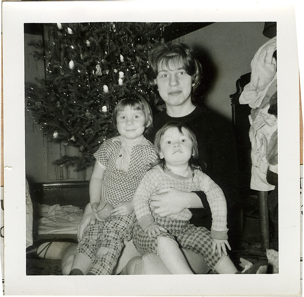 This 1963 family photo shows Donna Willing, left, with her sisters, Susan and Barb at Christmas. Donna was raped and strangled in 1970.