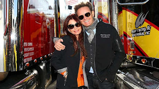 Roma Downey and her husband Mark Burnett at a NASCAR race in Virginia.
