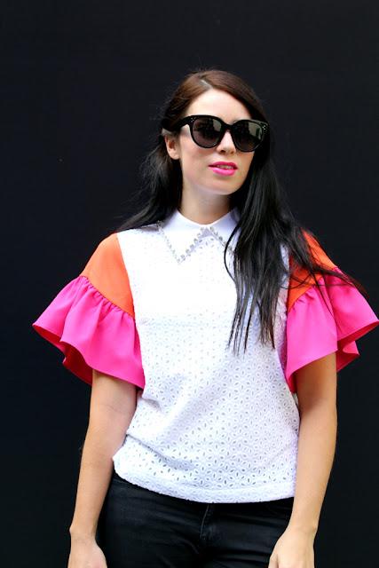 Emma Louise Layla in Cici London ruffle blouse at London Fashion Week
