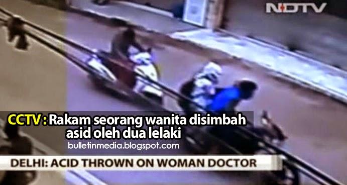 CCTV rakam seorang wanita disimbah asid oleh dua lelaki