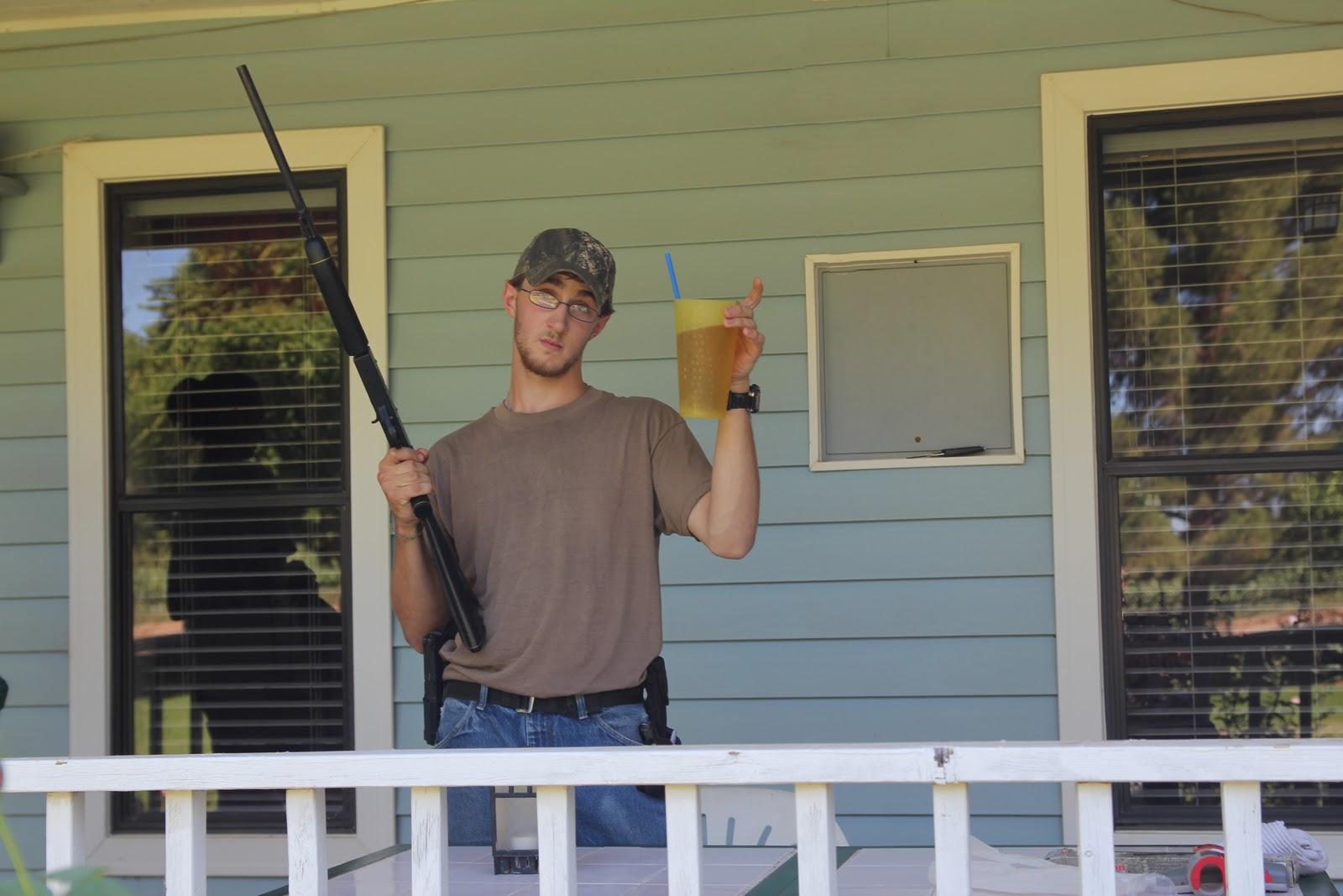 Redneck luxury sighting in a pellet gun on the front porch and drinking sweet tea does it get better than that