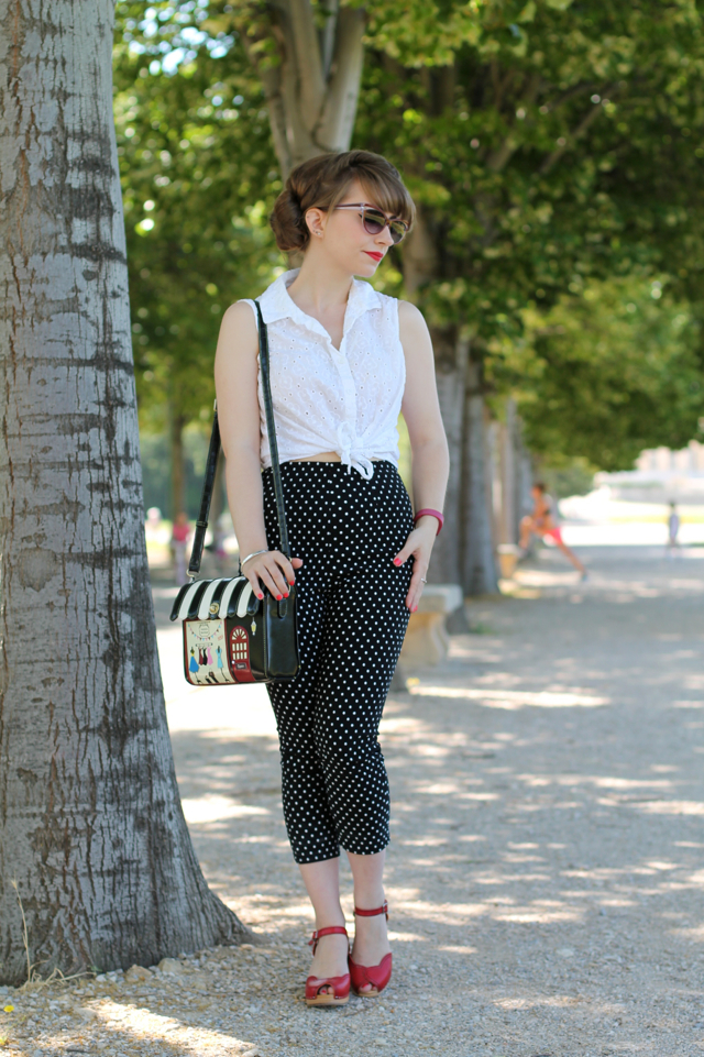 White tie shirt, polka dot capris, Vendula London bag and red Swedish Hasbeens