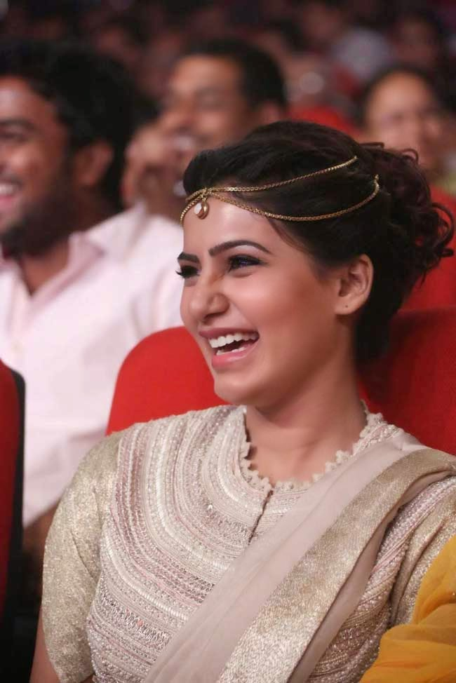 Samantha In Bun Hairstyle with Chain Hair Accessory