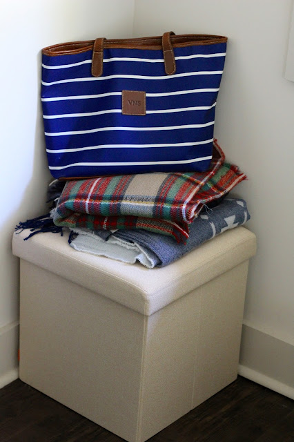 Pink Poppin Box Seat in the Master Bedroom with a mountain of blanket scarves  and the St. Anne Tote in French Stripes