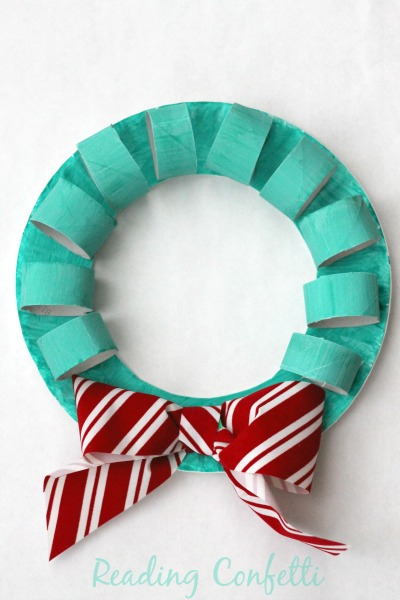 An easy Christmas wreath crafts for kids using cardboard tubes and paper plates