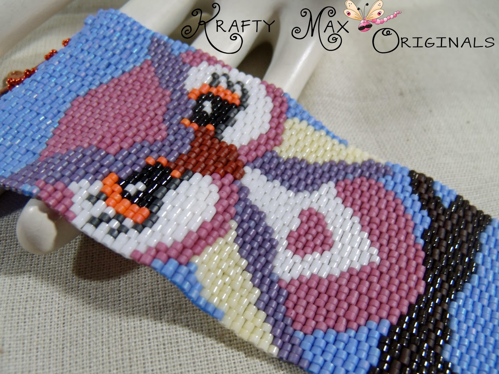 http://www.artfire.com/ext/shop/product_view/KraftyMax/8533617/peaceful_owl_and_a_branch_handmade_beadwoven_bracelet/handmade/jewelry/bracelets/beadwork
