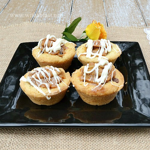 Turtle Cookie Cups ~ Quick, easy and delicious Cookie Cups filled with Chocolate Chips, chopped Pecans, Caramel and topped with another Pecan Nut and drizzled with White Chocolate #CookieCups #TurtleCookies www.WithABlast.net
