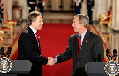 Power tools. George W Bush and Tony Blair shake hands at a White House press conference.  Photo by Paul Morse, for the US Government, via Wikimedia Commons - public domain.
