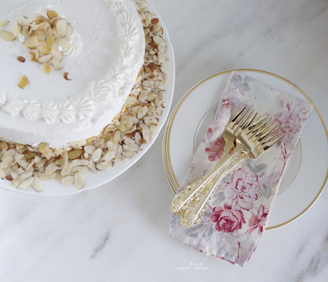 Cake and floral napkins with gold flatware