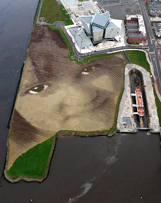 An aerial picture shows Britain and Ireland's largest land art entitled Wish at Belfast's Titanic Quarter in Northern Ireland. Spanning 11 acres, the artwork, by Cuban-American artist Jorge Rodriguez-Gerada, is made up from 30,000 pegs, 2,000 tonnes of soil and 2,000 tonnes of sand. The land art shows the face of an anonymous six-year-old Belfast girl. Rodriguez-Gerada said the land art, which was put together with the help of an army of local volunteer, is the largest he has ever produced.