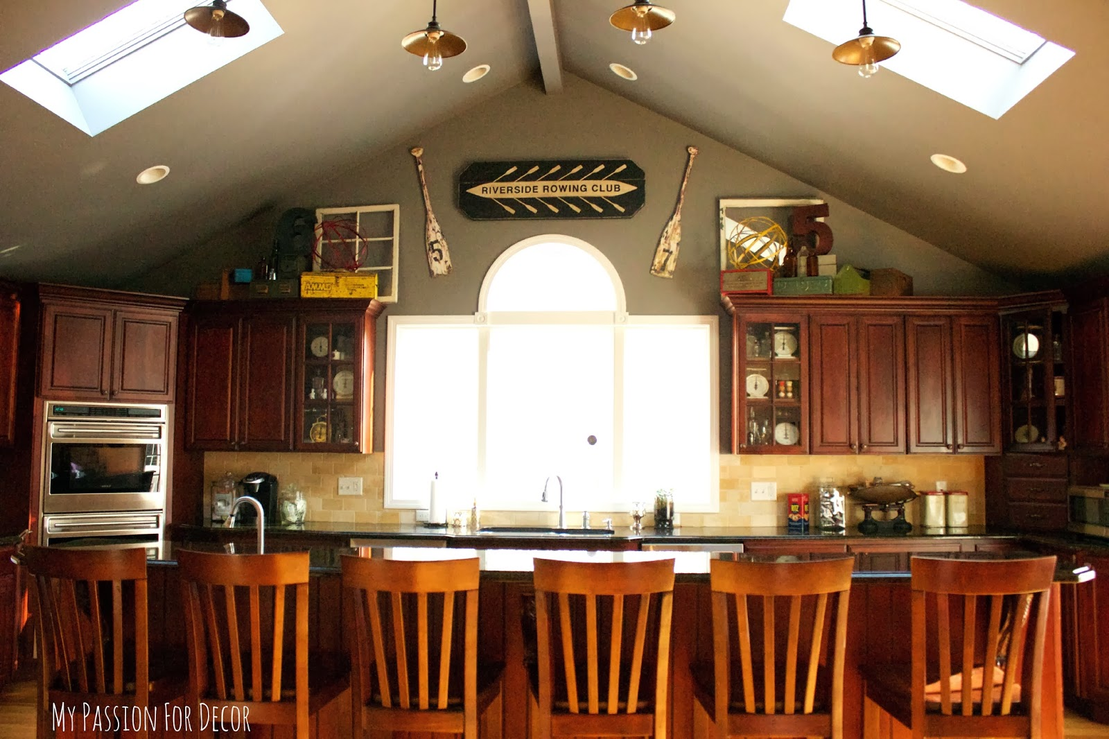 decorating above kitchen cabinets with vaulted ceilin