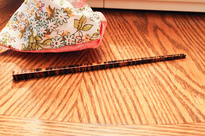 Use a chopstick, pencil, knitting needle, or hair stick to get the corners