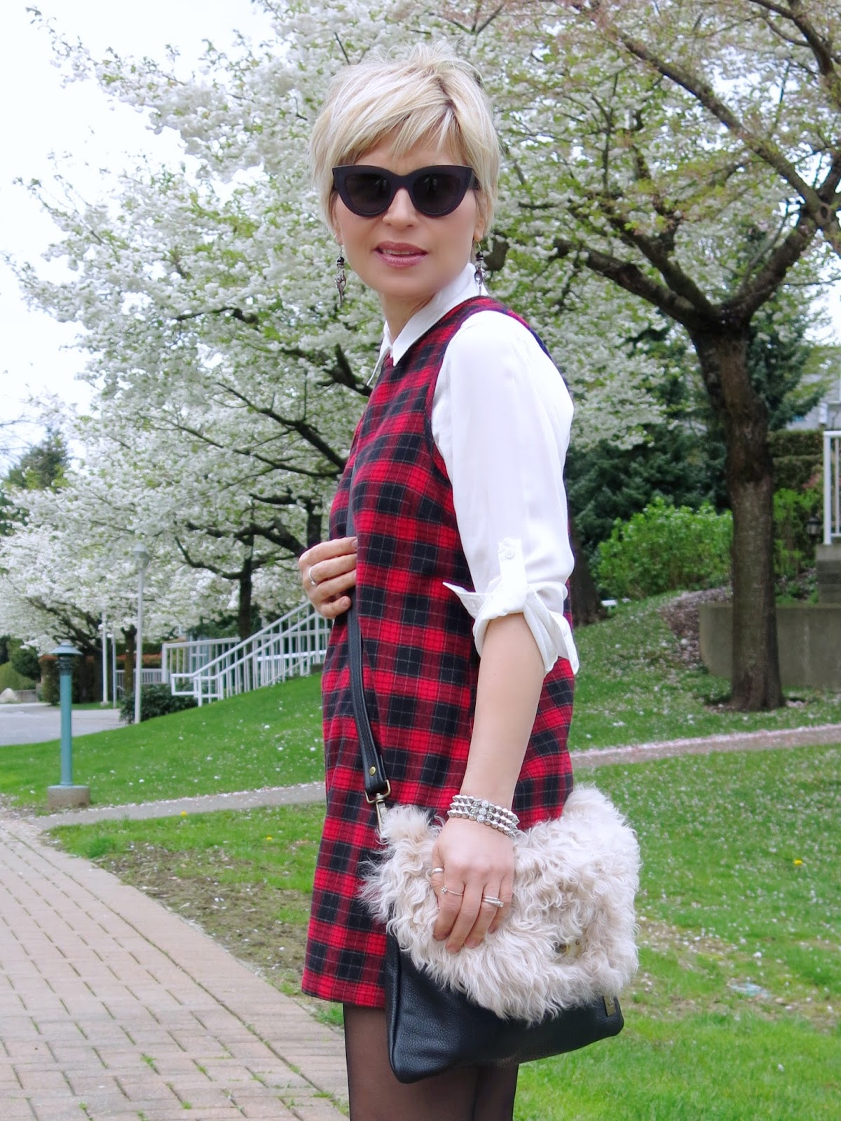 styling a white button-down shirt under a red plaid dress