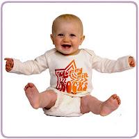 Baby wearing Mummy Milk Rocks t-shirt