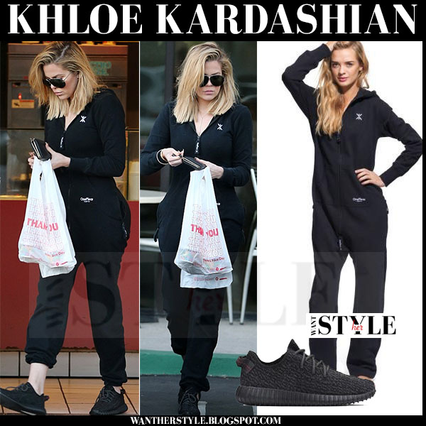 Khloe Kardashian in black onepiece onesie and black sneakers what she wore streetstyle