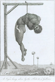 Blake: A Negro hung alive by the Ribs to a Gallows.