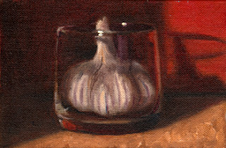 Oil painting of a garlic bulb inside an old fashioned glass with red background.
