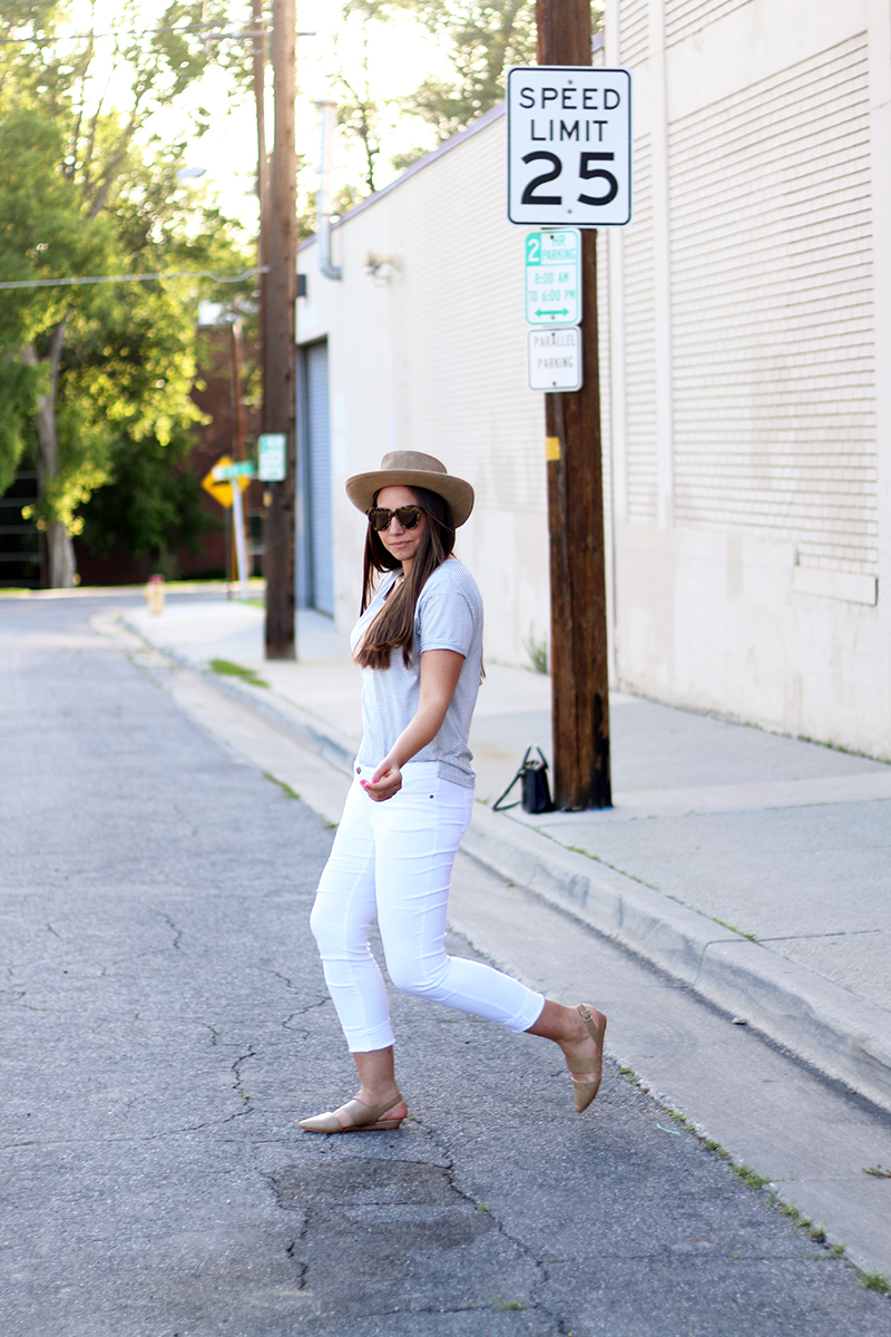 casual summer outfit with striped tee, hat, and white pants