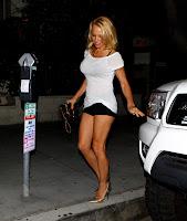 Pamela Anderson wearing a tiny shorts and see through shirt