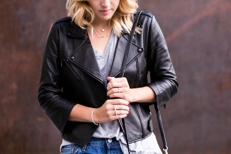 leather jacket and silver jewelry