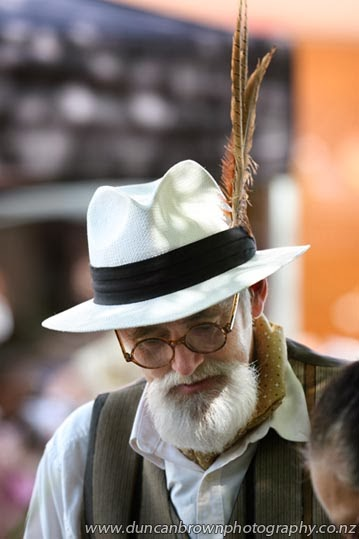 Finished off with feathers, man with feathers in his hat photograph
