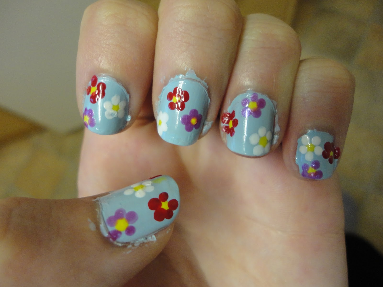 Nail art spring flower nails one of the yellow dots on each finger to make the flowers again if you arent using the same colours as me this should be your darkest colour mightylinksfo