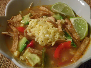 Closeup of Bowl of Chili Lime Soup with Toppings