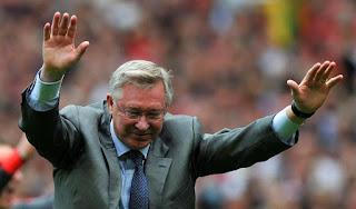 Alex Ferguson salutes the Stretford End at Old Trafford