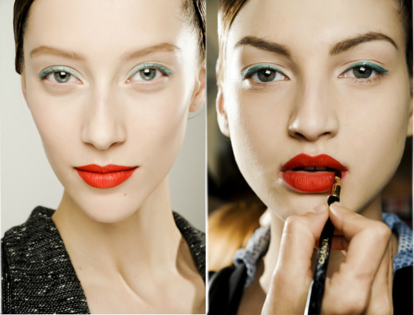 Beauty look from Raf Simons for Jil Sander Fall 2011: Jade cat eye liner, cherry red lips