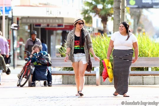 L-R: Rawinia Woods, Napier, Terewai Elkington, Napier, out enjoying the warm weather at lunchtime in the Hastings CBD. MetService recorded Hastings temperature between 15.9 and 16.7 degrees during the shoot. At day-end, Hawke's Bay recorded the warmest weather in NZ, 17.4 degrees, against Tuesday's forecast of a cold change and 14 degrees. photograph