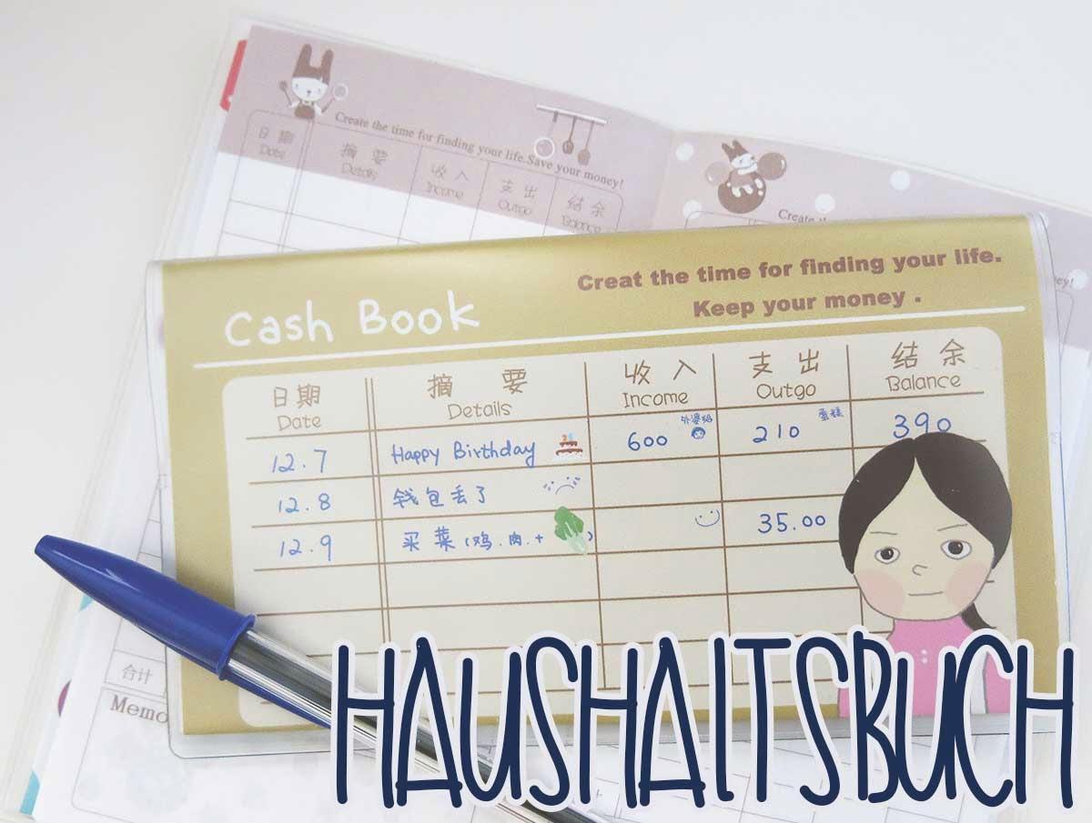 Haushaltsbuch Logo: Bild von zwei Haushaltsbüchern aus Korea mit Kugelschreiber davor.