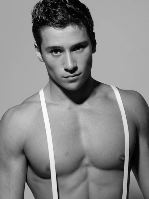 shirtless renato ferriera in black and white