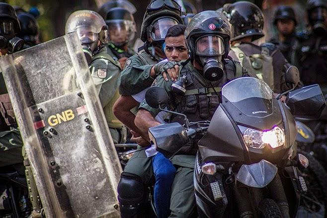 http://4.bp.blogspot.com/-QsPGM3RUD0k/U2gvFnXcz3I/AAAAAAAAIVk/-RIL5v4vDic/s1600/2014_venezuela_protest_PRESSER.jpg