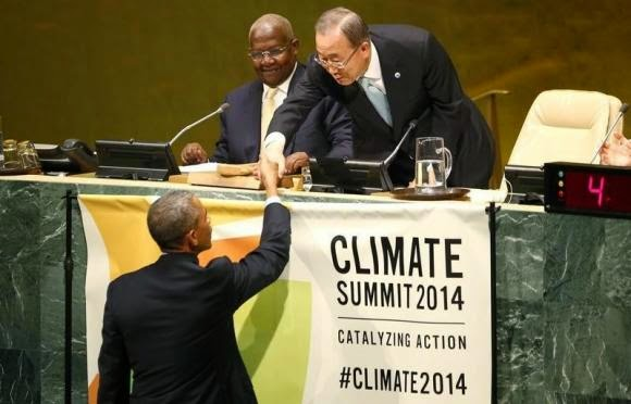 U.S. President Barack Obama (L) is greeted by United Nations Secretary-General Ban Ki-Moon (R) before addressing the Climate Summit at United Nations headquarters in New York, September 23, 2014. (Credit: Reuters/Kevin Lamarque)  Click to enlarge.