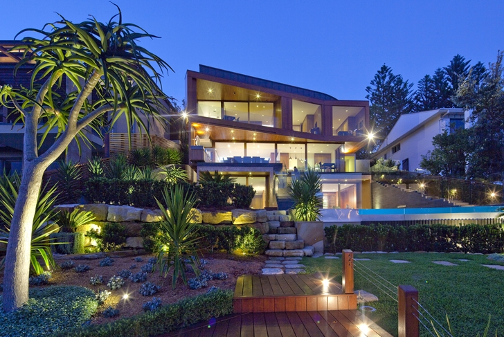 Contemporary style home at night